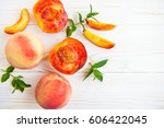 fresh peaches with mint on... | Shutterstock . vector #606422045