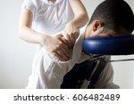 businessman receiving shiatsu... | Shutterstock . vector #606482489