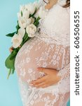 belly of a pregnant woman ... | Shutterstock . vector #606506555