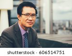 thoughtful senior businessman... | Shutterstock . vector #606514751