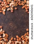 mixed nuts on a dark background....   Shutterstock . vector #606540641