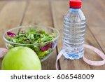 green salad in glass bowl ...   Shutterstock . vector #606548009