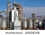 Chemical plant infrastructure with the blue sky in the background - stock photo