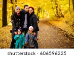 walking family with two