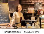 Small photo of small business, people and service concept - happy woman or barmaid at counter with cashbox in cafe or coffee shop