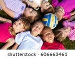 happy group of children lying... | Shutterstock . vector #606663461
