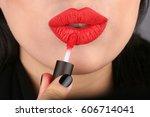 beauty red lips applying matte... | Shutterstock . vector #606714041