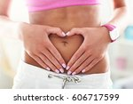 fit woman stomach | Shutterstock . vector #606717599