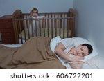 young tired mother got a sleep... | Shutterstock . vector #606722201