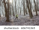 runner is running through misty ...   Shutterstock . vector #606741365