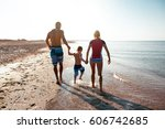 happy family hold hands and run ... | Shutterstock . vector #606742685
