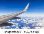 wing of the plane flying over... | Shutterstock . vector #606765401