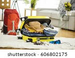 preparation travel suitcase at... | Shutterstock . vector #606802175