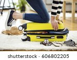 preparation travel suitcase at... | Shutterstock . vector #606802205