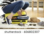 preparation travel suitcase at... | Shutterstock . vector #606802307