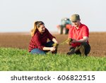 young farmers examing  planted... | Shutterstock . vector #606822515