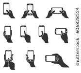 hand holding smartphone | Shutterstock .eps vector #606828524