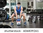 handsome man lifting kettlebell ... | Shutterstock . vector #606839261