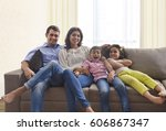 portrait of family relaxing on... | Shutterstock . vector #606867347