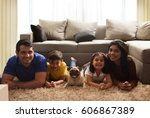 happy family with pug posing on ... | Shutterstock . vector #606867389