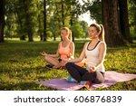 friends enjoying relaxing yoga... | Shutterstock . vector #606876839