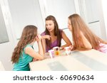 three young female friends... | Shutterstock . vector #60690634