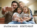 family taking sefie picture on... | Shutterstock . vector #606914669