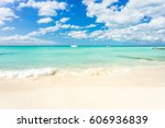 an idyllic beach on isla... | Shutterstock . vector #606936839