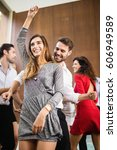 group of young friends dancing...   Shutterstock . vector #606949589