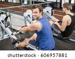 fit men on drawing machine at... | Shutterstock . vector #606957881