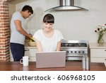 woman using laptop in kitchen... | Shutterstock . vector #606968105