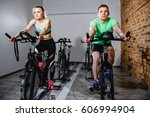 young man and woman biking in... | Shutterstock . vector #606994904