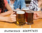 friends toasting with beers at...   Shutterstock . vector #606997655