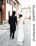 look from behind at groom in... | Shutterstock . vector #606999731