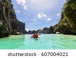 kayak in the island lagoon... | Shutterstock . vector #607004021