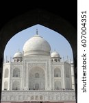 Small photo of Iconic view of the Taj Mahal mausoleum in Agra, India, from an arched portal of the adjacent mosque