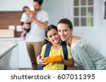 portrait of smiling mother and... | Shutterstock . vector #607011395