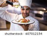handsome chef pouring olive oil ... | Shutterstock . vector #607012154