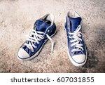 old sneakers on grunge... | Shutterstock . vector #607031855