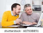 smiling adult and young...   Shutterstock . vector #607038851