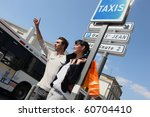 man and woman at a taxi stop | Shutterstock . vector #60704410