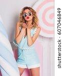 positive cute blonde woman send ...   Shutterstock . vector #607046849