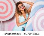 stunning  blonde woman posing...   Shutterstock . vector #607046861