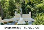 Statue Of A Girl. Arboretum...