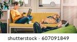 woman wearing yellow sweater... | Shutterstock . vector #607091849
