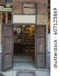 Small photo of RAATCHA-BURY, THAILAND- FEB 19:An unidentified souvenir shop uses the entrance door to the old wooden door that is double doors on February 19,2017 at Suan-Phueng in Raatcha-bury, Thailand.