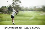 Lady Golf Swing On Golf Course