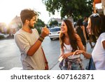 group of happy young friends... | Shutterstock . vector #607162871