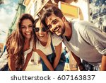 group of happy young friends... | Shutterstock . vector #607163837