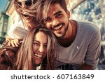 group of happy young friends... | Shutterstock . vector #607163849